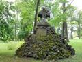 Zámek : Břežany - socha sv. Jana Nepomuckého v parku, druhotně osazena na pyramidě z přírodních kamenů - foto z 16. 6. 2014